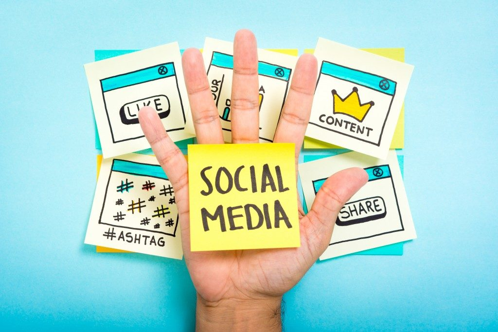 Social media on hand with blue background